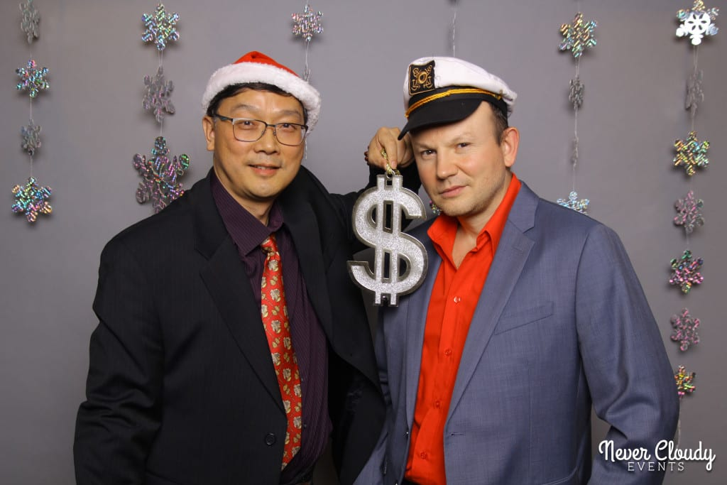 Funny pose for photo booth at holiday party