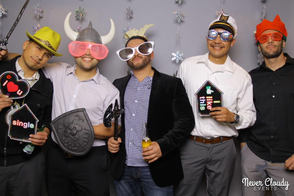 Group of guys at holiday party photo booth