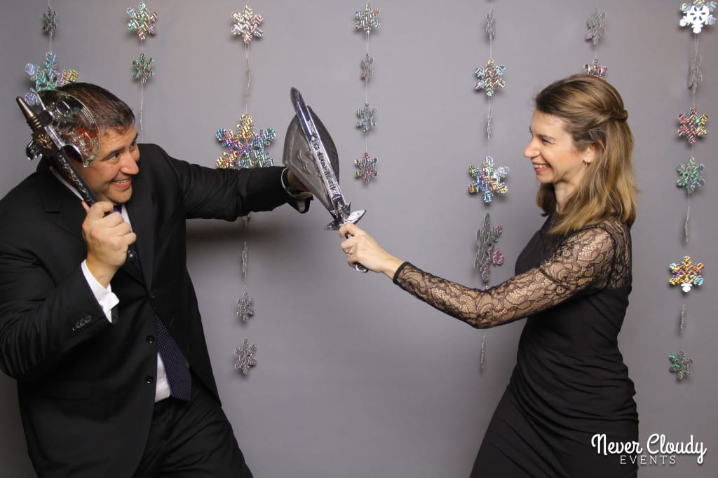 Couple in photo booth at Datcard holiday party