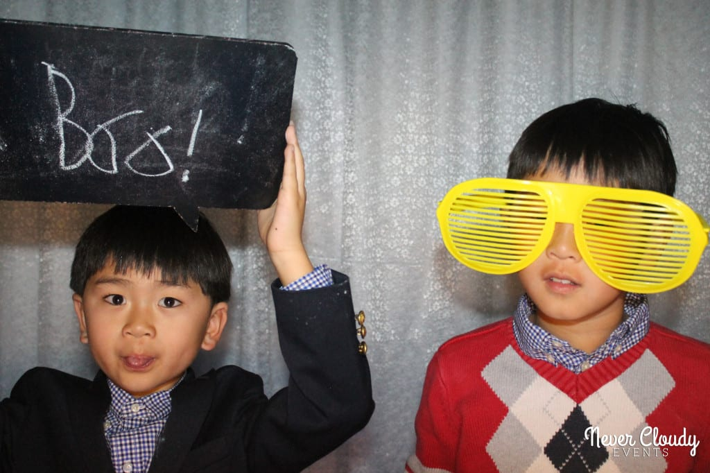 Two Asian kids in photo booth