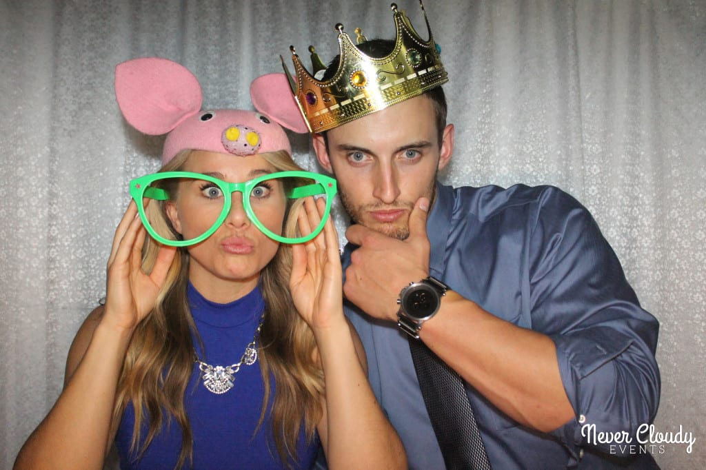 Photo booth couple posing with props